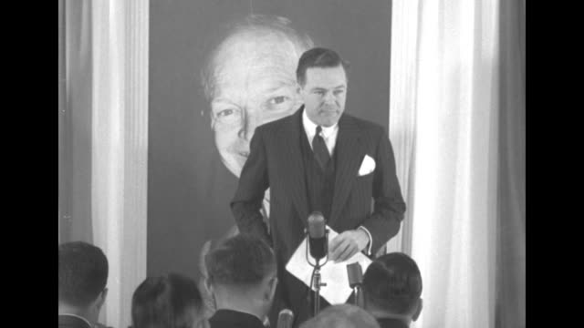 vídeos de stock, filmes e b-roll de standing in front of large picture of dwight eisenhower in eisenhower election headquarters ma sen henry cabot lodge jr prepares to speak to... - primary election