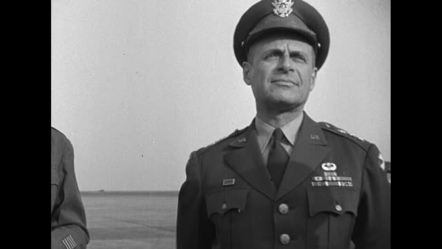 Standing next to airplane after landing at airport in Tokyo US special envoy John Foster Dulles speaks with General Matthew Ridgway Commander of US...