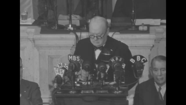 standing on rostrum in the us house of representatives' chamber of the us capitol, sot british prime minister winston churchill comments on increased... - winston churchill prime minister stock videos & royalty-free footage