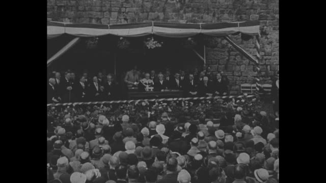 standing on stage amid part of ruins of rothesay castle, prince edward begins speech, audience in foreground / [note: exact day not known] [note:... - prince stock videos & royalty-free footage