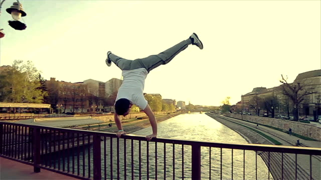 standing on the bridge,amazing acrobatics skill - acrobatic activity stock videos & royalty-free footage