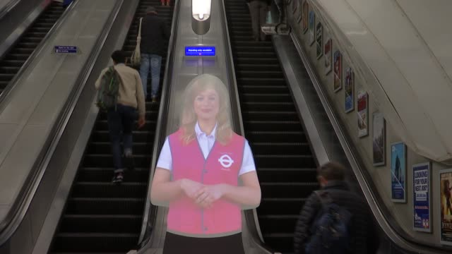 standing only escalator at holborn tube station; england: london: holborn int general views of escalator and hologram / hologram sot 'please stand on... - hologram stock-videos und b-roll-filmmaterial
