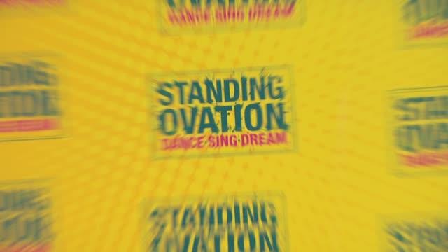 vídeos de stock e filmes b-roll de standing ovation logo at the 'standing ovation' premiere at universal city ca. - universal city