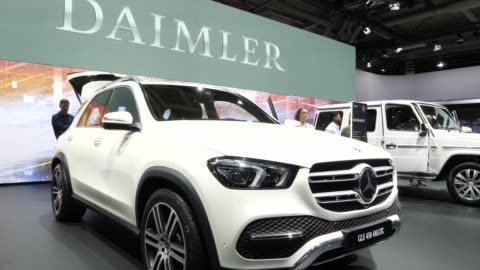 stands among vehicles on display at the annual daimler ag shareholders meeting on may 22, 2019 in berlin, germany. daimler has struggled with falling... - sports utility vehicle stock-videos und b-roll-filmmaterial