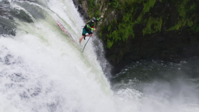stand-up paddle boarder goes over big waterfall - waterfall stock videos & royalty-free footage