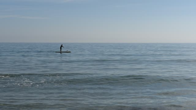 standup paddleboarding - distant stock videos & royalty-free footage