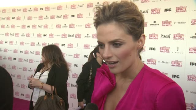 interview stania katic on what brings her out why the spirit awards are different from other and talks about why she chose her piaget ring at piaget... - stana katic stock videos and b-roll footage