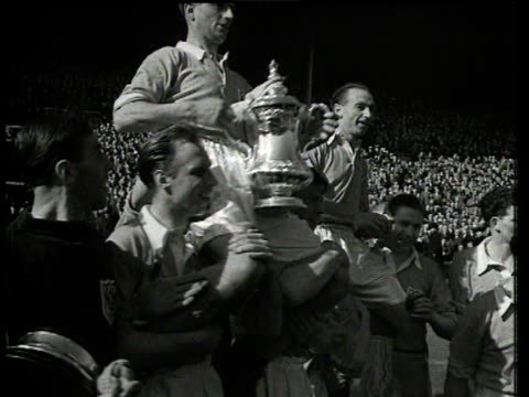 stanley matthews with teammates celebrating fa cup final victory, drinking champagne from trophy and posing with winner's medal, blackpool fc vs... - final round stock videos & royalty-free footage