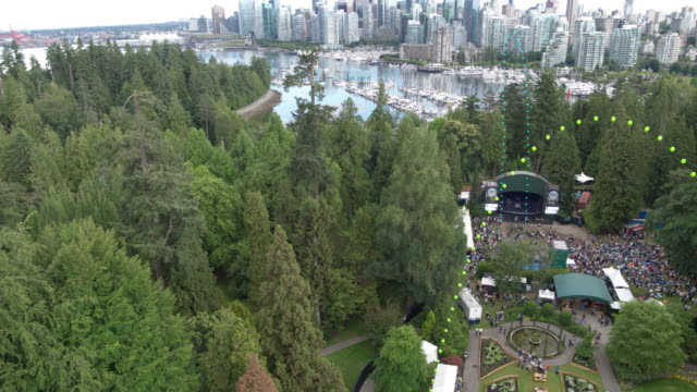 stanley park trees, city and stage | 4k drone - vancouver canada stock videos & royalty-free footage