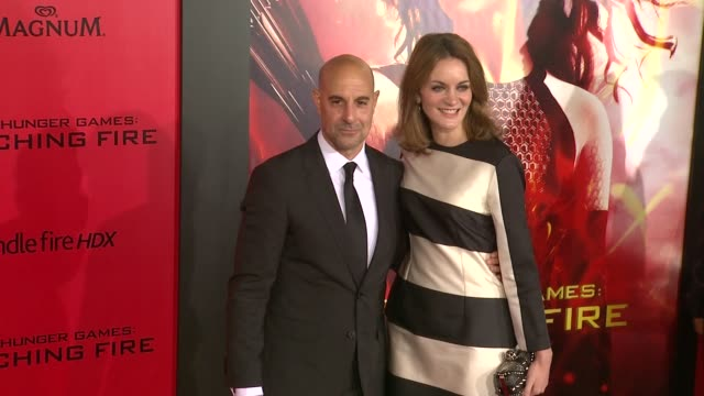 Stanley Tucci Felicity Blunt at The Hunger Games Catching Fire Los Angeles Premiere in Los Angeles CA on
