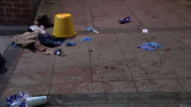 vidéos et rushes de crime scene gvs england london stanmore various of remains of medical kits on pavement outside sainsbury's store where a man was discovered with... - plaie