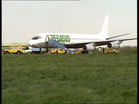 aircraft fire england stansted airport ms pegasus airways dc8 on tarmac with escape chutes out ms escape chutes from starboard doors to tarmac ms... - pegasus stock videos & royalty-free footage