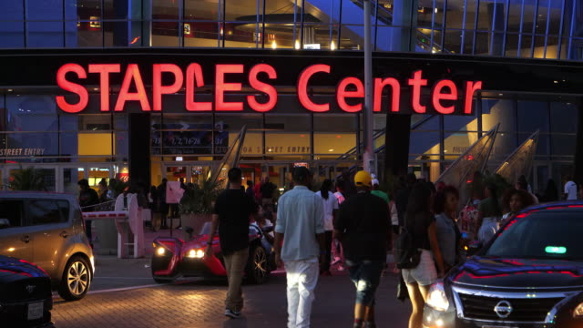 staples center at night near la live in los angeles downtown, california, 4k - staples center video stock e b–roll