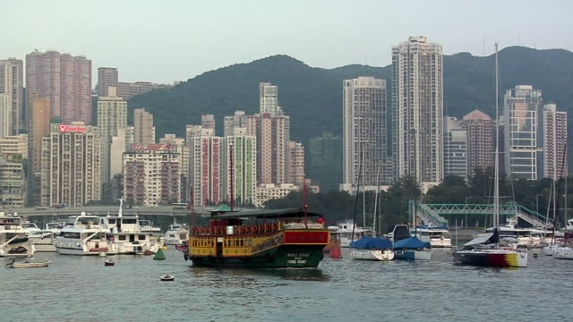 WS Star Ferry and sailboats in bay, Causeway Bay skyline in background / Hong Kong, China