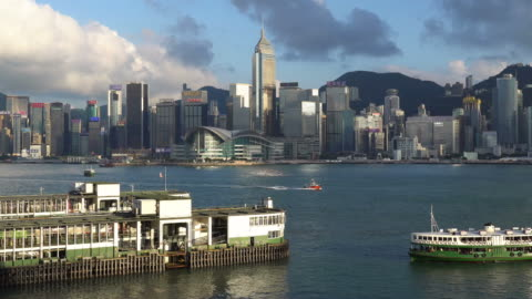 star ferry and the victoria harbour in hong kong - star ferry stock-videos und b-roll-filmmaterial