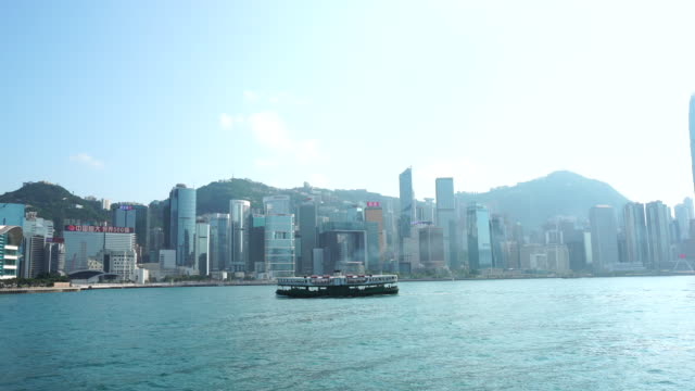 stockvideo's en b-roll-footage met star ferry bij victoria harbour hong kong island background - star ferry