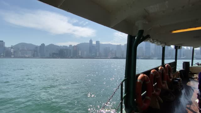 stockvideo's en b-roll-footage met star ferry boot leaving a wake on the water in tsim sha tsui pier in victoria harbour hong kong - star ferry