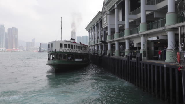 stockvideo's en b-roll-footage met star ferry departing from central towards tsim sha tsui in hong kong - star ferry