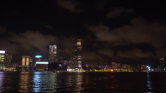 star ferry going across victoria harbour night light - star ferry stock videos & royalty-free footage