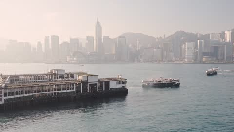 star ferry in victoria harbour in china sea overlooking the skyscrapers of central, hongkong. -wide shot - star ferry stock-videos und b-roll-filmmaterial