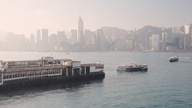 stockvideo's en b-roll-footage met star ferry in victoria harbour in china sea overlooking the skyscrapers of central, hongkong. -wide shot - star ferry