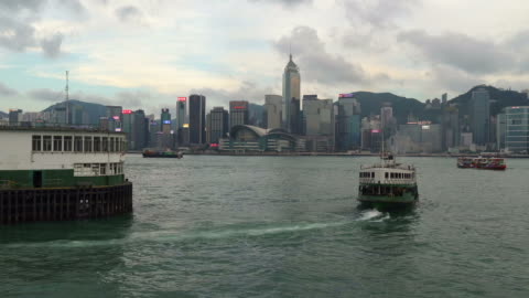 star ferry on the victoria harbor in hong kong - star ferry stock-videos und b-roll-filmmaterial