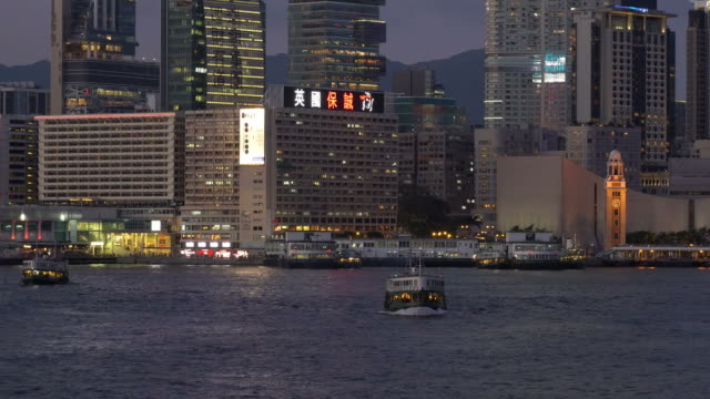 stockvideo's en b-roll-footage met star ferry on victoria harbor in hong kong - star ferry