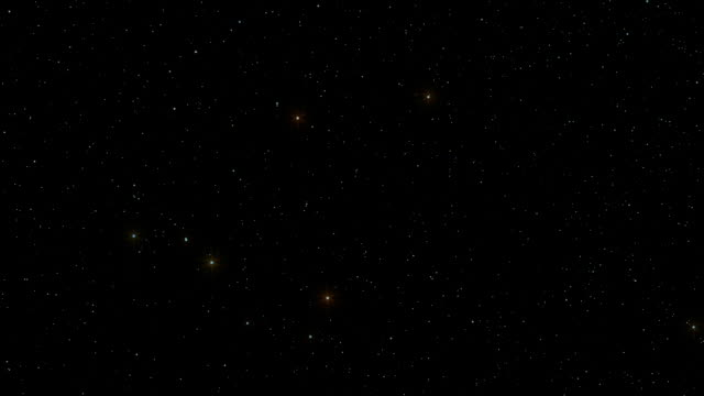a star field twinkles in a night sky - a forma di stella video stock e b–roll