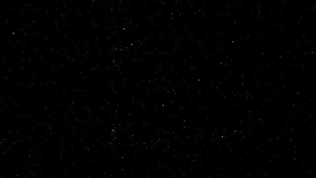 a star field twinkles in a night sky - 星点の映像素材/bロール