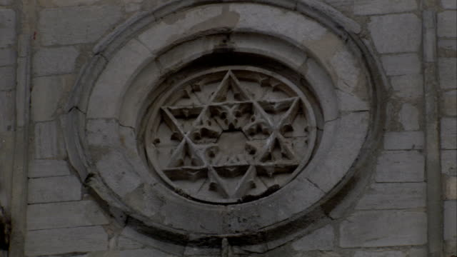 a star of david fills the recess of a medallion on the abbey gate, bury st edmunds. available in hd. - bury st edmunds stock videos & royalty-free footage