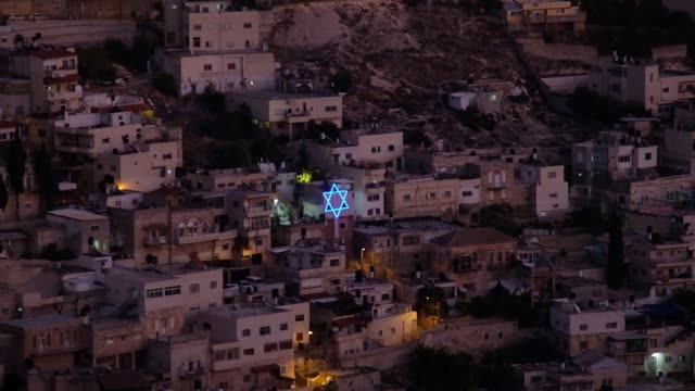 star of david neon adorning houses belonging to jewish settlers in the heart of silwan a palestinian neighborhood in east jerusalem israel - human settlement stock videos & royalty-free footage