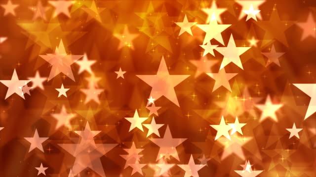 オレンジ色の背景の星の粒子