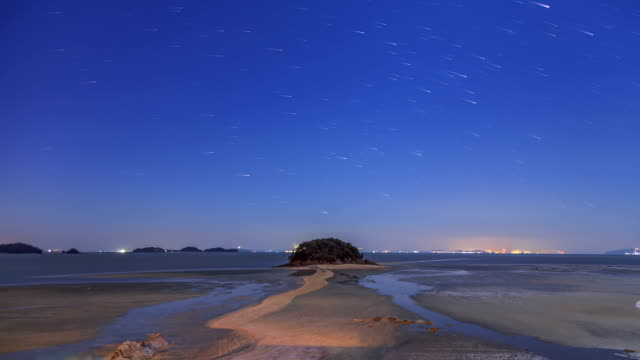 Star Trail and Night Landscape of Mokseom(Natural Landmark) in Seonjaedo island at High tide