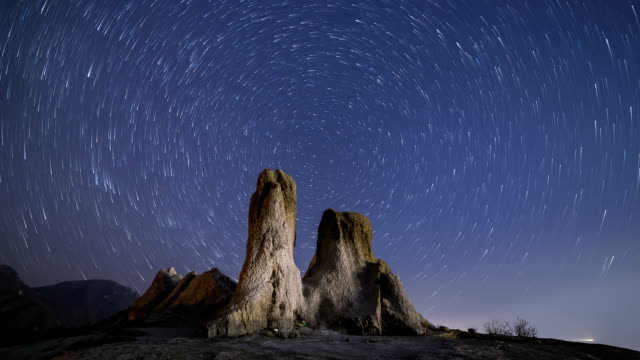 star trail and ulsan rock at mt.seoraksan - star field stock videos & royalty-free footage