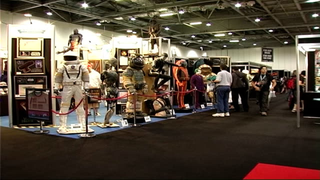 Star Wars exhibition at Docklands ENGLAND London Docklands Excel Centre Star Wars Exhinition INT Crowds looking at Stars Wars exhibits including...