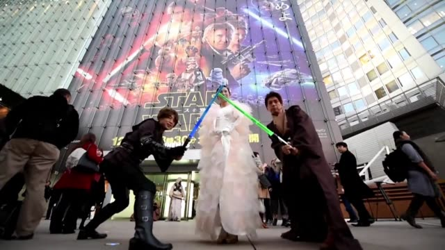 star wars fans dressed as lightsaber wielding jedis stormtroopers and wookies gather in front of a movie theatre in tokyo to celebrate the release of... - star wars film series stock videos & royalty-free footage
