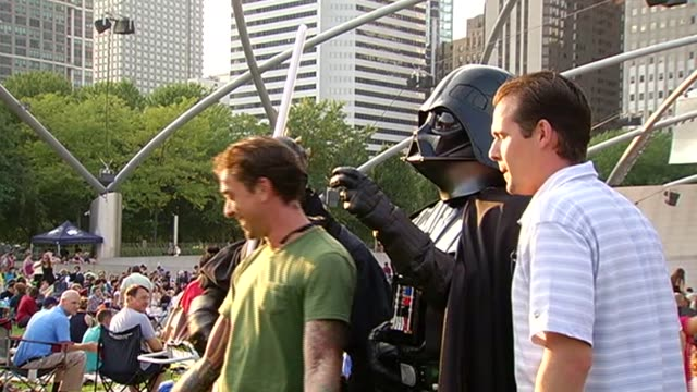 star wars fans watched episode 4 at the last movie of the city's summer film series. star wars fan watch film in millennium park at millenium park on... - star wars film series stock videos & royalty-free footage