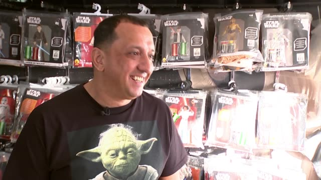 star wars themed shop 'jedi robe' cashes in on latest film release england london northolt star wars toys and collectables hanging on racks close... - 小さな像点の映像素材/bロール