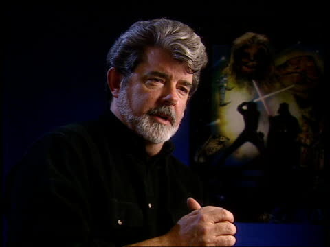 vídeos de stock, filmes e b-roll de 'star wars' twenty years on itn exculsive exclusive can be licensed please contact itn source sales staff for information*** london george lucas... - george lucas