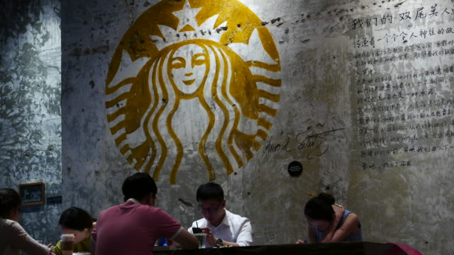 vídeos de stock, filmes e b-roll de starbuck reserve coffee shops have already surpassed 110 stores in china,accelerating to boost starbucks's upgrade in china starbucks 2017q2 earnings... - starbucks