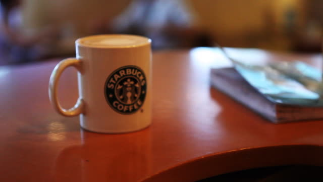 Starbucks barista prepares and serves beverage in China