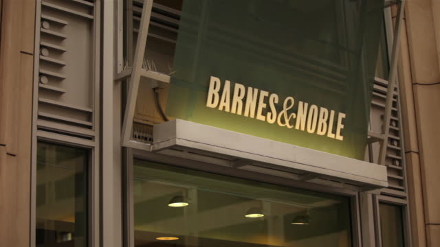 ms starbucks cafì© logo in barnes noble store window tu generic nook table advertisement ms various exterior signage of store - barnes & noble stock videos and b-roll footage