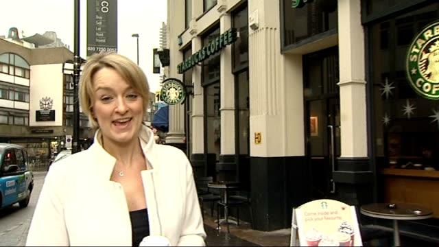 starbucks google and amazon face mps questions on tax london ext starbucks coffee shop pan reporter to camera mark adams along in bookshop hand... - ローラ・クエンスバーグ点の映像素材/bロール