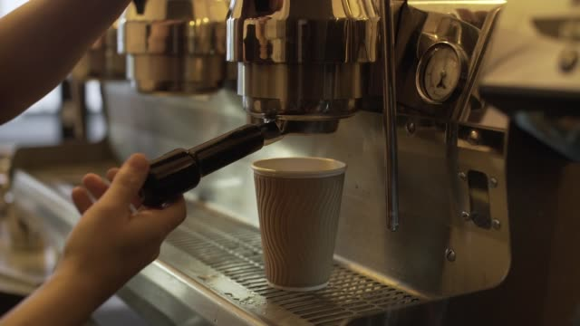 vídeos de stock, filmes e b-roll de 35 starbucks stores introduce a 5p 'latte levy' on plastic cups london close shot coffee being made at espresso machine coffee going into plastic cup... - starbucks