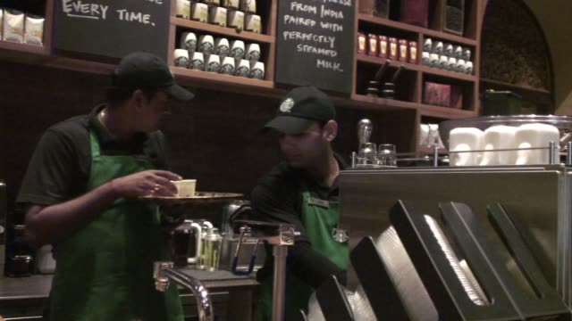 starbucks the worlds biggest coffee chain launched its first indian outlet friday in an upscale part of mumbai becoming the latest global firm to tap... - caffeine stock videos & royalty-free footage
