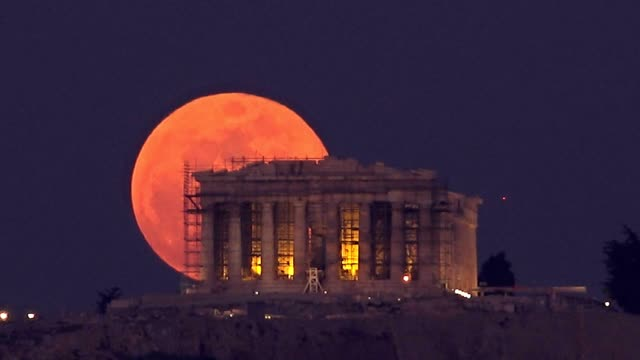 stargazers in athens had the chance to witness a rare 'super blue blood moon' rising behind the parthenon temple on the acropolis of athens tonight... - supermoon stock videos & royalty-free footage
