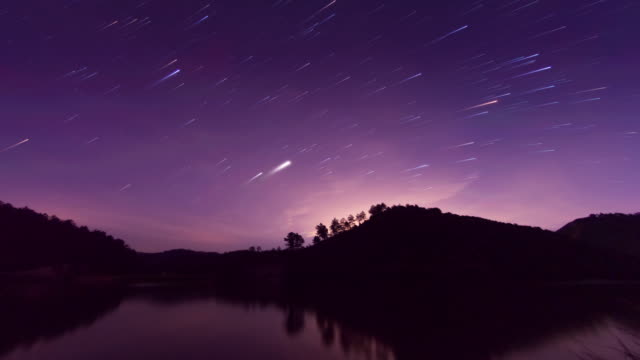 starry sky romantic meteor shower 4k - romantic sky stock videos & royalty-free footage
