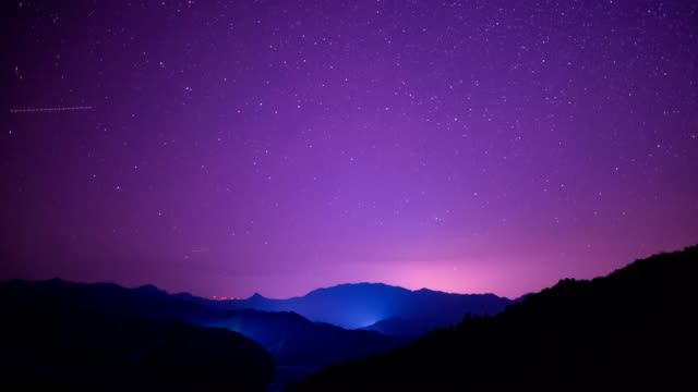 starry sky scene on rolling hills 4k video - purple stock videos & royalty-free footage