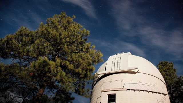 t/l ws la tu stars and clouds moving across sky over telescope at lowell observatory / flagstaff, arizona, usa - lowell stock videos & royalty-free footage