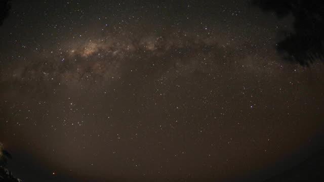 stars and milky way drift through night sky, madagascar - galaxy stock videos & royalty-free footage